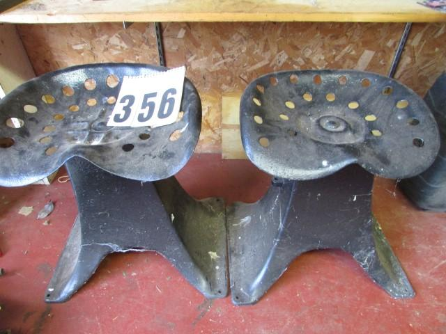 2 old metal tractor seats mounted on iron frames - Current